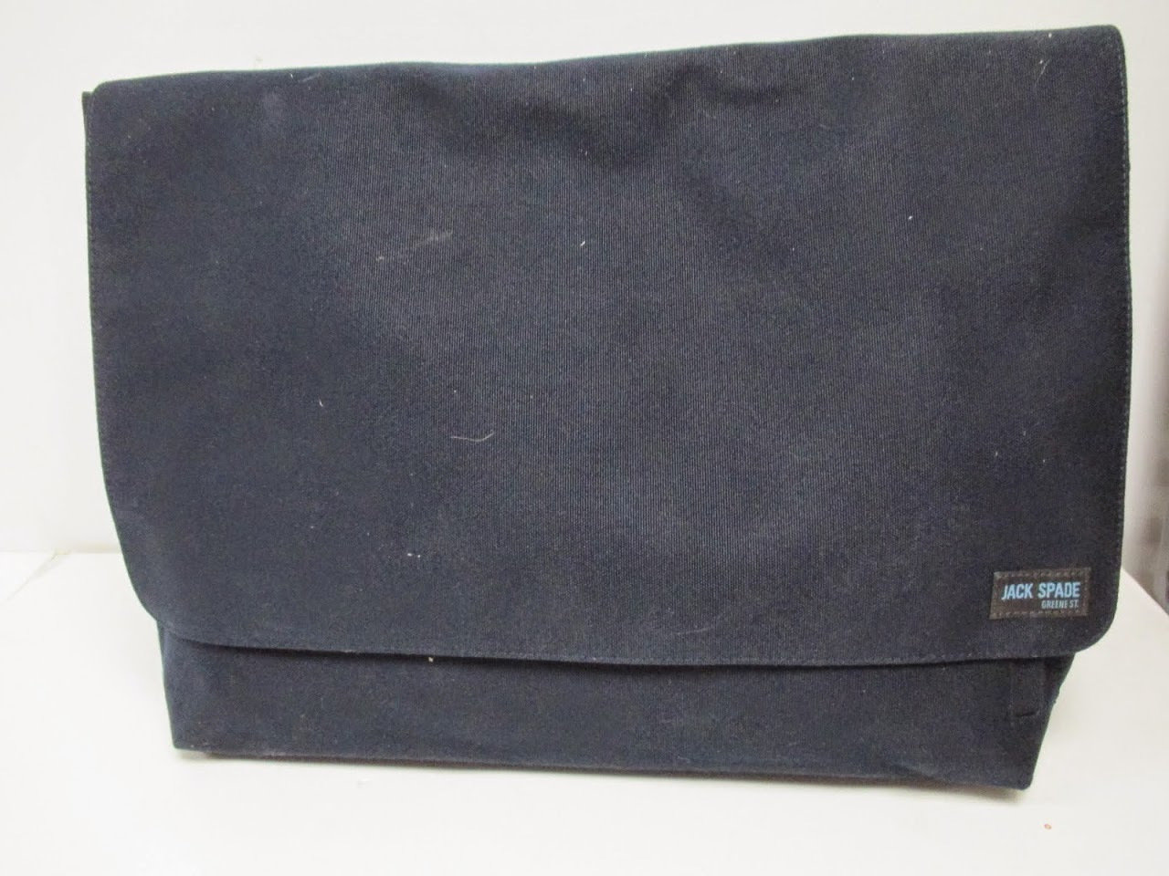 housing-works-jack-spade-navy-messenger-bag